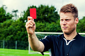 Angry referee shows a red card