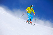 Men snow skier skiing on sunny ski resorts  Winter sport