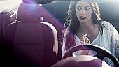 beautiful woman driving a car
