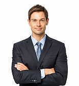 Well-Dressed Businessman Standing Arms Crossed