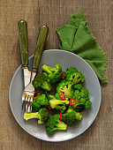 Broccoli with sauce and spices.