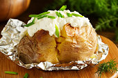 Baked potato with cream of the cream cheese closeup.