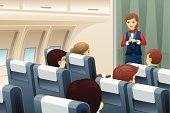 Flight attendant demonstrate how to fasten the seat belt