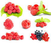 Collection of ripe red raspberries on white background.