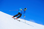 Beautiful senior men snow skier skiing on sunny ski resorts