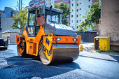 Heavy tandem Vibratory roller compactor working on asphalt pavement