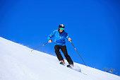 Snow skier skiing