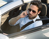 successful man in a convertible car