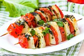 Potato vegetarian kebab, skewer with vegetables, tomato, herb