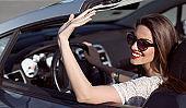 beautiful smiling woman driving  a car