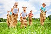 Five kids jump in sacks