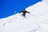 Mature men off piste skiing  powder snow  sunny ski resorts