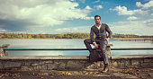 Panoramic photo of handsome man on the lake
