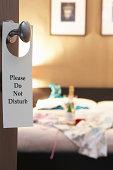 """Do Not Disturb"""""""" sign on hotel room's door"""
