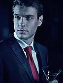 young elegant man having a martini