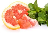 Grapefruit fruit with mint isolated on white