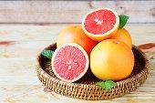 juicy grapefruit on a wicker tray