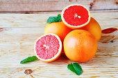 heap ripe grapefruit on a wooden background