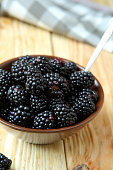 ripe and juicy blackberries in a bowl