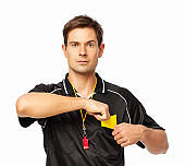 Confident Soccer Referee Removing Yellow Card From Pocket