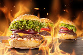 Fresh hamburgers with fire flames