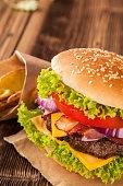 Fresh hamburger on wooden planks