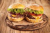 Fresh hamburger served on wood