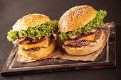Fresh hamburgers on black stone