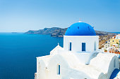 Church with blue dome on Santorini Island (Cyclades Islands, Greece)