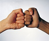 Close-up of two hands knocking fists