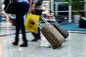 People walking at airport (motion blur)