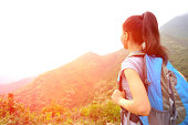 hiking woman stand at mountain peak