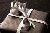 Black gift box on shiny background.