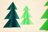 Paper Christmas trees. Winter background. Ecology concept