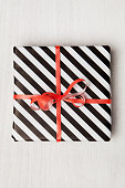 Gifts on white wooden table. Christmas background. Birthday celebration