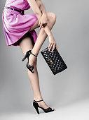 woman legs in black high heels shoes