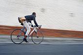riding bike black man