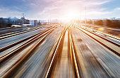 Blurred railway with setting sun