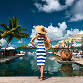Woman sailor striped in dress near poolside