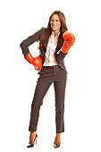 Tough businesswoman with boxing gloves