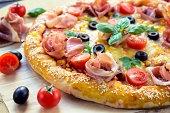 Tasty prosciutto pizza