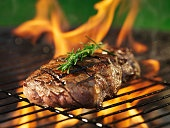 steak barbecue with flames