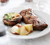grilled strip steak with potatoes and stuffed mushroom