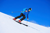 Beautiful mature men snow skier skiing on sunny ski resorts