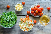 Tricolore farfalle with arugula, parmesan and cherry tomatoes
