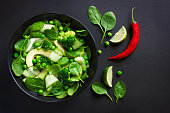 Healthy food. Fresh green salad.