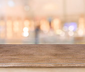 Empty wooden table and blurred abstract background