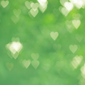 Abstract background heart shape bokeh in green tone
