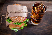 Takeaway homemade hamburger with cold drink