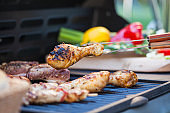 Close-up of chicken meat grilling on barbecue grill